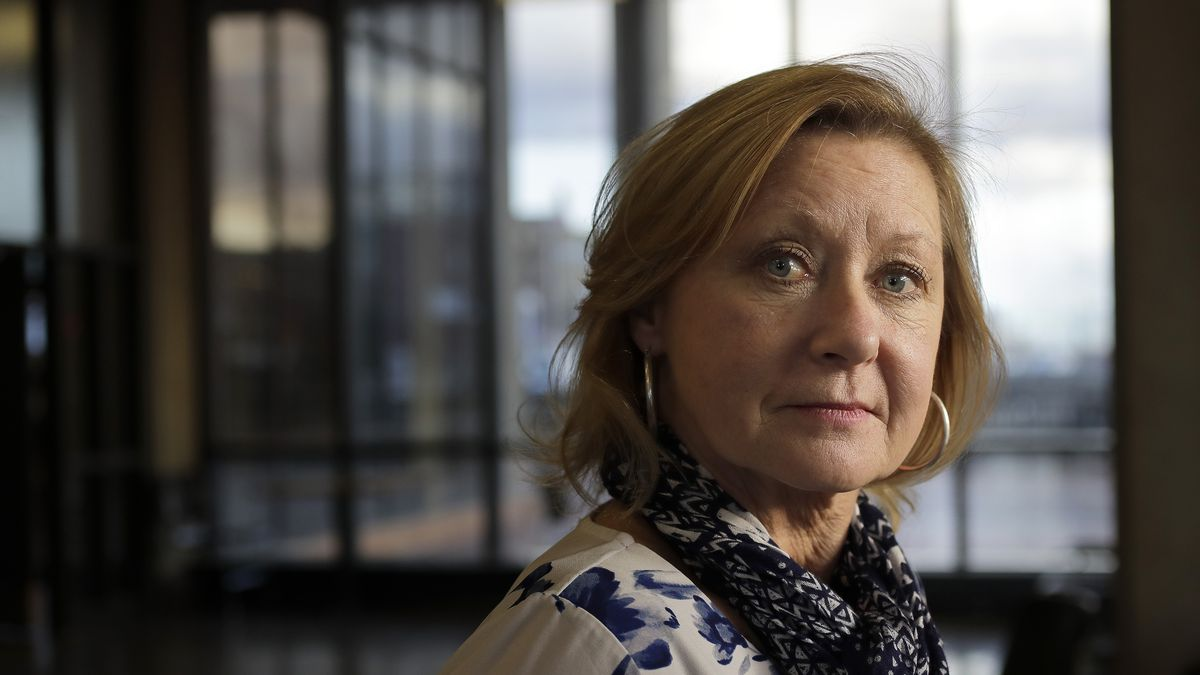 """In this Thursday, Jan. 16, 2020 photo Jo Goode, city hall reporter for The Herald News of Fall River, Mass., stands for a photo, in Fall River. Goode, who had reported extensively on the Fall River mayor's indictment on federal extortion charges, didn't expect that in 2018 the mayor would create an anonymous website, with her name as the address, featuring an endless loop of a video clip of President Donald Trump saying """"You are fake news!"""" (AP Photo/Steven Senne)"""