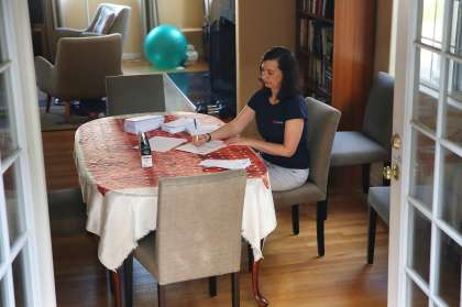 Debbie Raucher, an organizer with Swing Left, works on a political letter campaign at her Oakland home.
