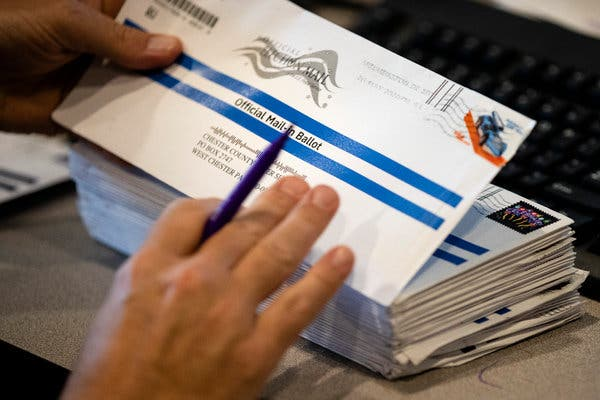 Early mail-in ballots were processed at the Chester County voter services office in West Chester, Pa., on Thursday.