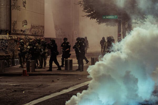 Federal agents clashed with protesters in Portland, Ore., on Tuesday. President Trump has strained to tie images of unrest in American cities to his Democratic opponent, Joseph R. Biden Jr.