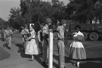 Image: Elizabeth Eckford, right, is turned away by Arkansas National Guardsmen as she approaches Little Rock Central High School on Sept. 4, 1957. The guardsmen were instructed by Gov. Orval Faubus (D) not to allow nine black students to enter the school, despite federal court orders.