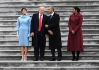 Image: With their wives by their sides, Trump and former president Barack Obama speak on the steps of the Capitol after Trump was sworn in on Jan. 20, 2017.