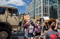 Image: Protesters march to the White House down 16th Street NW on June 7.