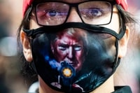 Image: A Trump supporter waits for President Trump to arrive for a campaign rally at the BOK Center in Tulsa on June 20.