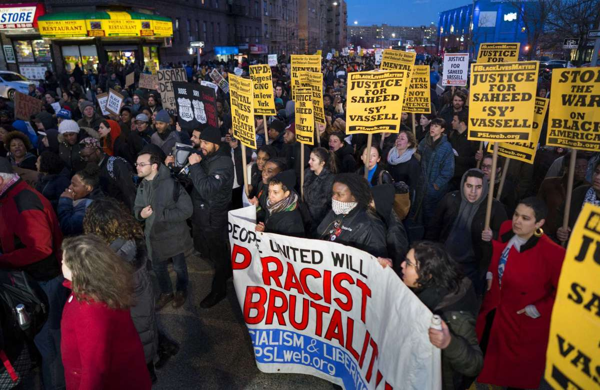 Protesters march towards the New York Police Department's 71st Precinct on Empire Boulevard to protest Wednesday's fatal police shooting of Saheed Vassell, a 34-year-old father of a teenage son, Thursday, April 5, 2018, in the Brooklyn borough of New York. (AP Photo/Craig Ruttle)