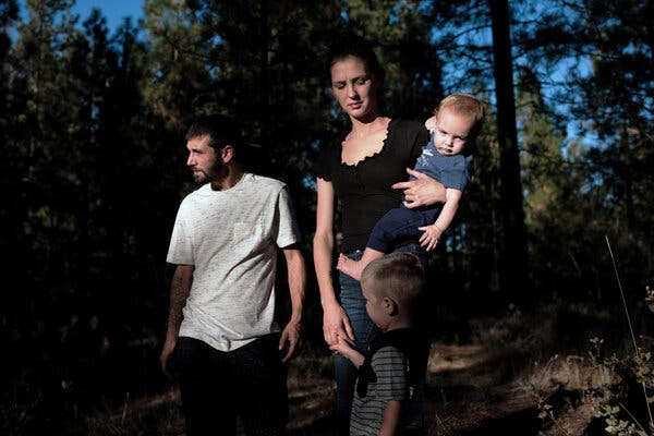 Richard Musa and his wife, Kristin Jeffcoat, with their children this week at their home in Camptonville, Calif. When schools closed in the spring, Ms. Jeffcoat, an Instacart shopper, stayed home to watch their children, and then her husband got laid off from landscaping work.