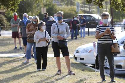 Bexar County residents wait to cast their votes Tuesday at the Lion's Field polling site.