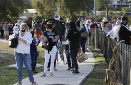 Voters line up outside the Lion's Field polling site Tuesday. The county has opened 48 polling sites, including new mega locations for this year's early voting