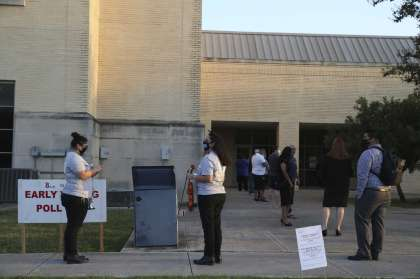 People line up to vote at the Our Lady of the Lake University polling site Tuesday. Theresa Lankford, one of the first people to cast a ballot at the new polling location, said she and her husband, Roland, chose it because they expected few people to be there.