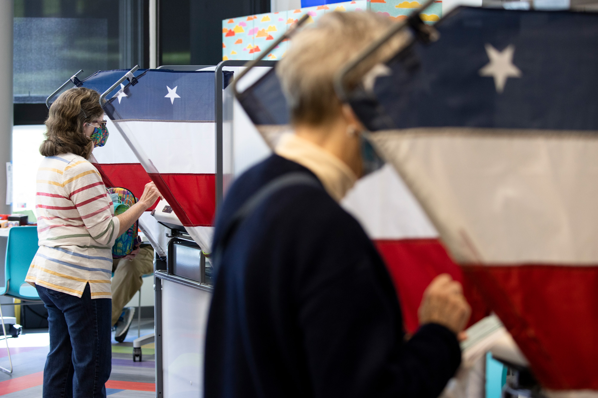 Voters cast their ballots during early voting at a Nashville Public Library building on October 14 in Nashville, Tennessee.