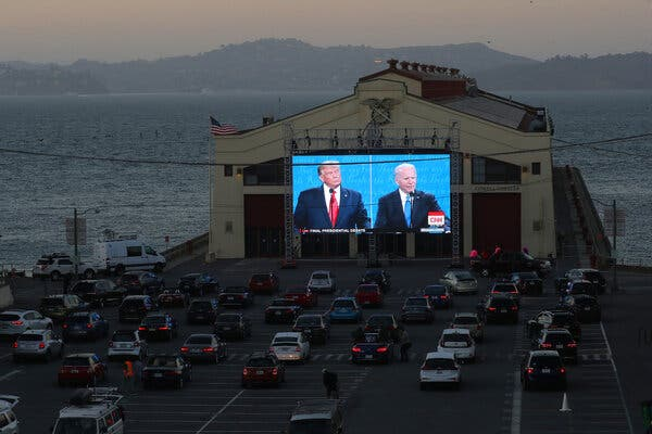 People watching the final presidential debate at a pier in San Francisco.